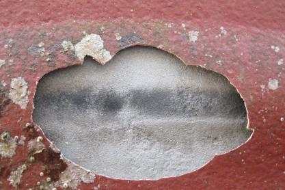 Burn marks visible behind coating